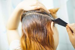 Woman combing hair stock image