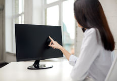 Close up of woman with computer monitor in office Stock Photography