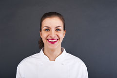 Close-up woman cook cheff over dark wall Stock Image