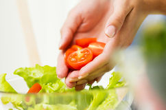Close up of woman cooking vegetable salad at home Stock Image