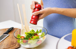 Close up of woman cooking vegetable salad at home Stock Images