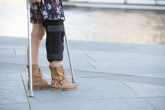 Close up of woman with crutches Stock Photos
