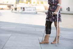 Close up of woman with crutches Royalty Free Stock Images