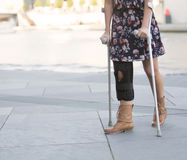 Close up of woman with crutches Royalty Free Stock Photos