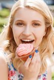 Close-up of woman with cupcake Stock Images