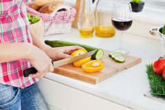 Close-up of a woman cutting paprika at home Stock Image