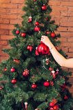 Close up of woman decorating Christmas tree Stock Images