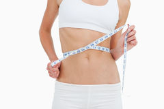 Close-up of a woman on diet measuring her waist Royalty Free Stock Photos