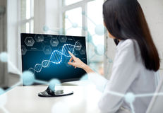 Close up of woman with dna molecule on computer Stock Images