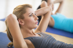 Close-Up Of Woman Doing Sit-Ups At Gym Stock Images