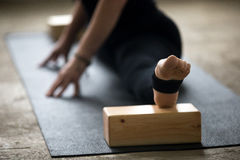 Close up of woman doing splits with block for deep stretch Stock Photo