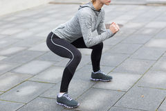 Close up of woman doing squats outdoors Royalty Free Stock Images