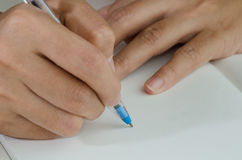 Close-up of a woman drawing into her diary. By ballpoint pen Stock Photo