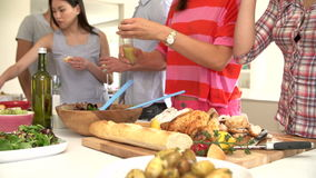 Close Up Of Woman Dressing Salad At Dinner Party Stock Photos