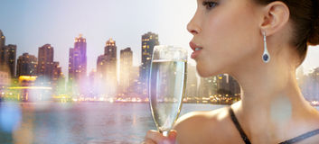 Close up of woman drinking champagne in night city Stock Images