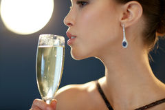 Close up of woman drinking champagne at party Royalty Free Stock Images