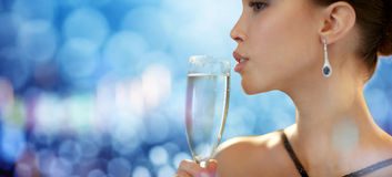 Close up of woman drinking champagne at party Royalty Free Stock Image