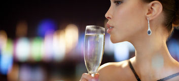 Close up of woman drinking champagne at party Stock Photography