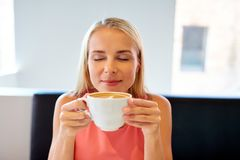Close up of woman drinking coffee at restaurant Royalty Free Stock Photography