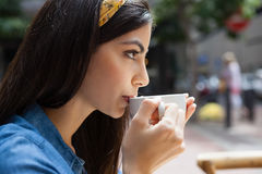 Close up of woman drinking coffee. While sitting at cafe Royalty Free Stock Photo