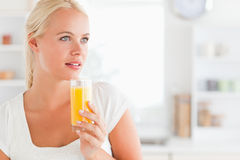 Close up of a woman drinking orange juice Royalty Free Stock Image