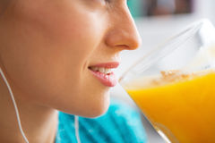 Close-up on  woman drinking pumpkin smoothie Stock Images