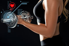 Close up of woman with dumbbell and pulse Royalty Free Stock Photo