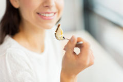 Close up of woman eating cake at cafe or home Royalty Free Stock Photography