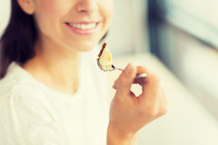 Close up of woman eating cake at cafe or home Stock Photo