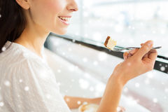 Close up of woman eating cake at cafe or home Stock Image