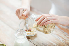 Close up of woman eating muesli for breakfast Stock Photo