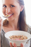 Close up of woman eating some cereals Stock Photo