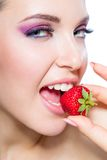 Close up of woman eating strawberry Stock Photo