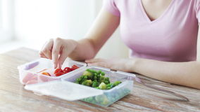Close up of woman eating vegetables from container stock video