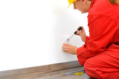 Close up of woman electrician fixing socket Royalty Free Stock Image
