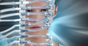 Close up of woman through electronics against blue motion blur Stock Image