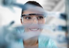 Close up of woman through electronics against blurry background Stock Image