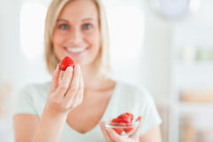Close up of a woman enjoying eating strawberries Stock Photo