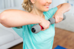 Close up of woman exercising with dumbbell at home Royalty Free Stock Image