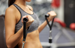 Close up of woman exercising on gym machine Stock Photography
