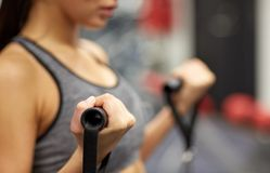Close up of woman exercising on gym machine Royalty Free Stock Photography