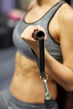 Close up of woman exercising on gym machine Stock Photo