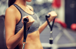 Close up of woman exercising on gym machine Royalty Free Stock Images