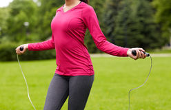 Close up of woman exercising with jump-rope Stock Photography