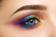 Close-up of woman eye with beautiful colourful makeup Stock Photo