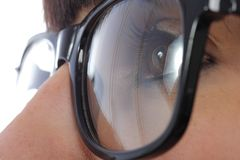Close-up of a woman eye with black glasses royalty free stock images