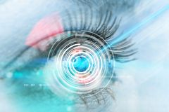 Close-up woman eye with laser medicine Royalty Free Stock Photos