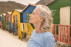Close up of woman with eyes closed standing against huts. At beach Royalty Free Stock Photos