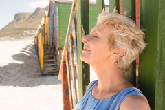 Close up of woman with eyes closed standing by hut at beach. On sunny day Stock Photography