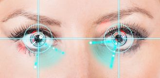 Close-up woman eyes with laser medicine. Royalty Free Stock Photo